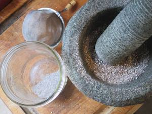 Stone morter and pestle with ground spices.