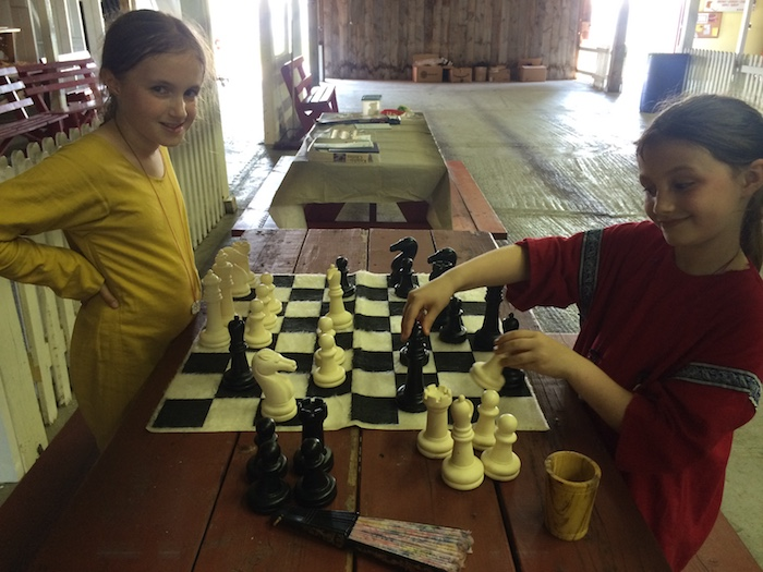 Two girls playing chess.