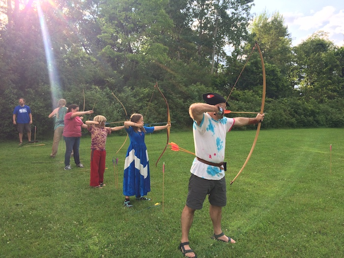 Archers in a line shooting.