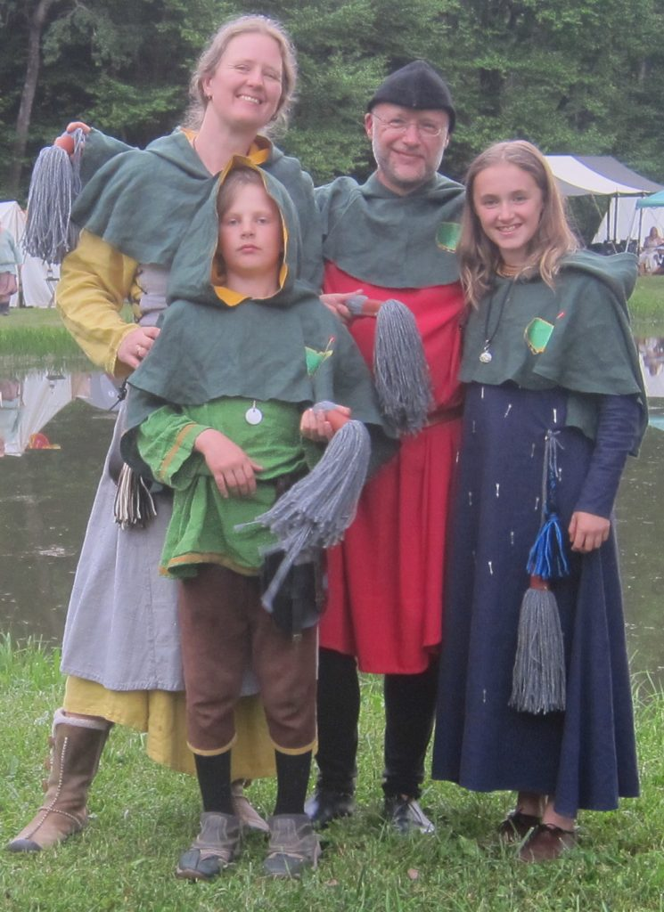 woman, boy, man, and girl in medieval clothing